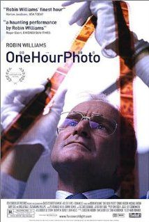 """One Hour Photo"" (2002). An employee (Robin Williams, in a dark role) of a one-hour photo lab becomes obsessed with a young suburban family. This is a fun thriller."
