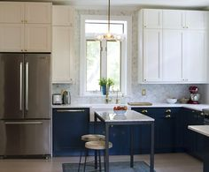 One way to do tall cabinets  Before & After: Rachel's Timeless Two-Tone Kitchen — The Big Reveal Room Makeover Contest 2015