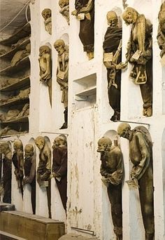 Italy's most ghoulish site, this crypt houses thousands of corpses, fully dressed and hung from hooks. The practice began in 1599 when local priests mummified a holy monk and allowed visitors. Soon regular residents of Palermo wanted to be remembered in this fashion. Bodies are arranged by gender and profession; their facial expressions often eerily visible.