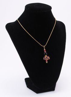 The colors on this piece are really pretty, Murano glass beads with pink flowers make up the pendant and earring dangles. The set has gold bead caps and separator beads and a splash more of fuchsia. These classy earrings and necklace would be ideal for evening wear. $25.00