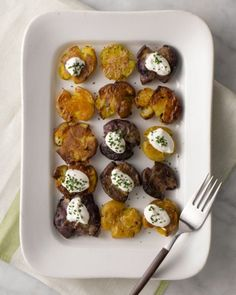 2 pounds small multicolored potatoes Coarse salt and freshly ground pepper 4 to 6 tablespoons olive oil 6 to 8 sprigs fresh thyme, picked ur cream, for serving (optional) Chopped fresh chives, for serving (optional)