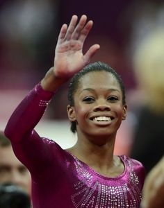Gabrielle Douglas of the U.S. waves after her floor exercise during the women's individual all-around gymnastics final in the North Greenwich Arena at the London 2012 Olympic Games August 2, 2012.