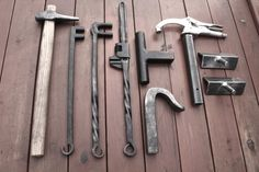 waldgeist86: Random blacksmith tools. 3/8 round hot punch, 3/8 & 3/4 scroll wrenches, Adjustable twist wrench, role bar hardy, traditional holdfast, vise grip hold fast, and an adjustable vise mount bending fork.