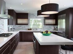 nice contemporary kitchen and especially like the backsplash and extra large light fixtures over the island
