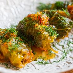 Mamushka author Olia Hercules makes pork-stuffed cabbage. Holubtsi (Ukrainian-Style Stuffed Cabbage) braised in tomato sauce. Chef Recipes, Cooking Recipes, Cookbook Recipes, Lamb Recipes, Recipies, Ukrainian Recipes, Braised Chicken, Tasting Table, Cabbage Recipes