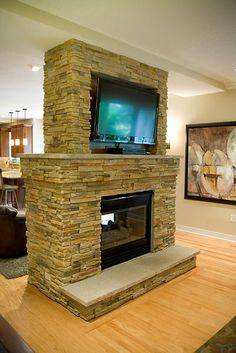 4 Sided See Through Fireplace With Stone Surround
