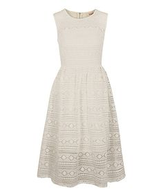 London-based Louche makes pieces with style to spare. This dress shows off a chic retro-inspired midi silhouette that's sure to be garden-party dynamite.Size note: This item runs in UK sizes. Please refer to the size chart.