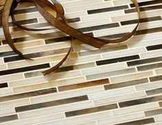 Groovy Stiix in Hard Day's Night  We love this tile as a border in bathrooms or kitchens in various color mixes and find that if you want to use multiple stones in a room this is a great way to tie them all together.