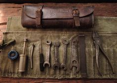 A 1930s Gamage of London leather motorcycle tool pouch & complete Whitworth tools and canvas pouch