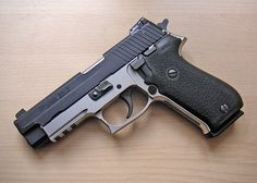 Sig Sauer 22LR conversion kit for P220 Find our speedloader now!  http://www.amazon.com/shops/raeind
