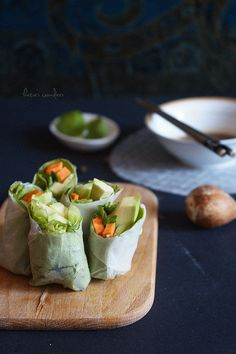 Carrot, avocado and cucumber in rice paper with sauce. A splendid and healthy snack