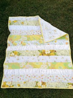 I really love this quilt and also the ruffle-like fabric..just different color pattern. (Pinks, blues, greens)