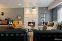 i love how the shapes in the rug work with the shapes in the fireplace