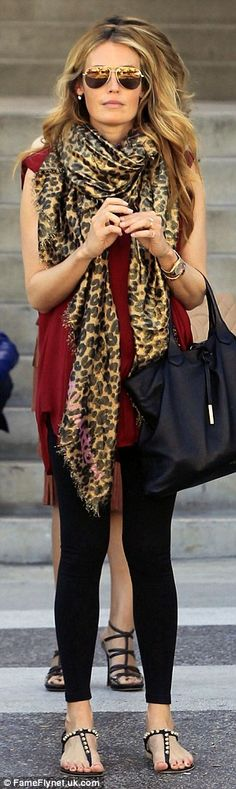 So stylish: She wore a loose-fitting maroon chiffon top over black skinny jeans and a pair...