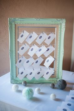 mint frame escort card holder and decor