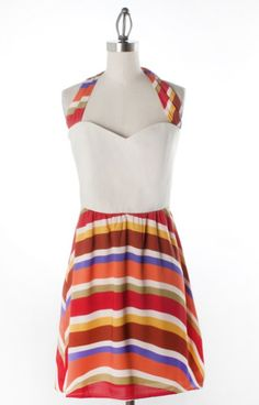 Judith March 574D1MLTThis halter dress is ideal for summer BBQs, showers, luncheons and so much more! Paired with your favorite strappy neutral wedges, this JM dress will brighten up your summer day. Put on a cardigan and wear this dress year-round! Match golden accessories and  youll see the colors in this dress pop!