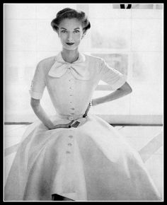Janet Randy in white piqué dress by Traina-Norell, Vogue, January 1952