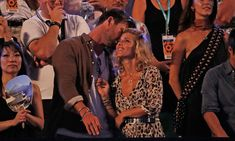 Elsa Pataky and Chris Hemsworth showed their love for each other as they watched Roger Federer and Marin Cilic play in the men's final during the Australia Open in Melbourne.