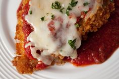 Lighter Baked Chicken Parmesean: This was a good recipe - it was very similar to the other chicken parmesean recipes I have tried. I had to cook the chicken a little longer than the recipe suggested - about 5 or 10 minutes - because one of the breasts didn't cook fully through. Overall, it was tasty, it just wasn't anything special compared to other recipes.