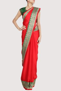 Red Sari featuring a broad green border. Shop Now: www.karmik.in/shopping/index.php