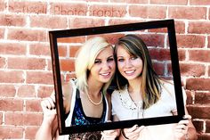 we should do this with the senior picture we had taken together...like us now holding it, I have it....somewhere....