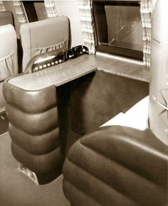 Mock-up of the suggested flight attendant's station with telephone and various light and sound system control panels in a Curtiss-Wright C-46 commercial passenger airplane. ©Missouri History Museum