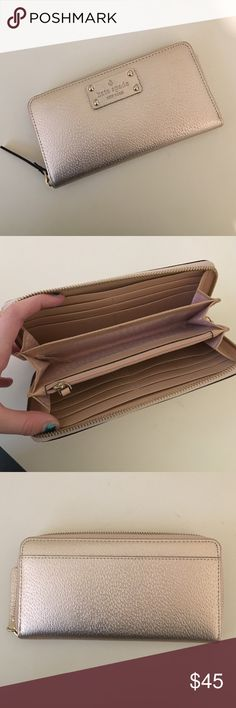 Late Spade Wallet i've never used it once, in great condition, rose gold in color :) kate spade Bags Wallets