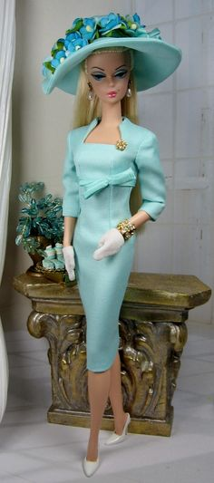 Aqua Belleza for Silkstone Barbie... a stunning linen sheath with a matching bowl on this empire waist turquoise dress. Along with its matching turquoise hat with blue flowers...