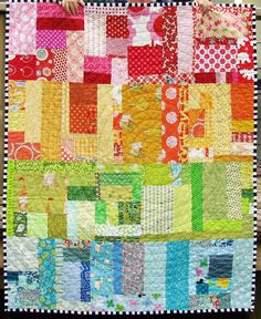 cute  colorful baby quilt!  Love the black and white binding and the circle quilting!