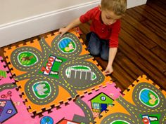 love this idea cause then he can change it up DIY idea use rubber paint and make your own using the mats we already have http://www.ehow.com/how_6744597_paint-puzzle-mats.html#