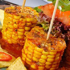This baked corn on the cob recipe is done in the oven.  These tasty corn cob sections are baked with salsa sauce.