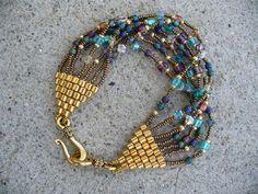 Inspiration: beautiful beaded/woven bracelet Found on bijoumadame.blogspot.co.uk