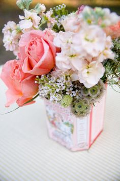 9. Floral arrangement - The blushy pink flowers and roses are great but the best part is the vintage tea tin. Perfect arrangement! (#modcloth #wedding)
