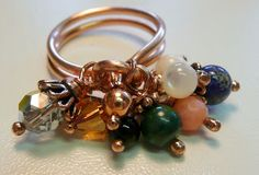 Love Knot Cluster Ring by Dana's Jewelry Design -  Good tutorial with plenty of photos.  Nice site to explore her other tutorials.      #handmade #jewelry #ring #beads #beading #wire