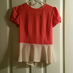 Light flattering blouse. Pink and cream blouse with back zip closure with clasp on top.  One of my very favorite tops. It's too small for me now.  I wore it twice and had it dry cleaned.  It's seriously sooo cute.  It's taken me forever to put it up on here. Tops Blouses