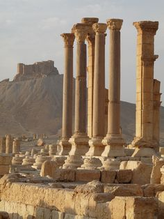 The Ruins of Palmyra with Qala' at Ibn Maan Castle sitting on the distant hillside.  Distant Ruins. By Ian Layzell