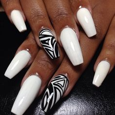 White & Black Abstracts on Coffin shaped nails...  Coffin shape... yes I like that.  I couldn't figure out the shape lol its wild  and  love it!