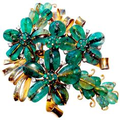 MAUBOUSSIN Trabert Hoeffer New York circa 1940 Emerald | MAUBOUSSIN Trabert Hoeffer New York circa 1940 Brooch in yellow gold set with cabochon drop cut emeralds and diamonds, signed