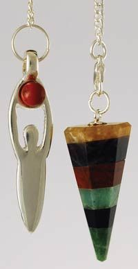 """Creatively styled with a silver-toned representation of the goddess holding a jasper stone over her head on one end of its chain, and a conical, layered gemstone pendulum bob on the other, this pendulum is a unique piece that could be used in a wide range of spells and divination methods. The conical bob measures approximately 1 1/2"""" in length, while the goddess symbol hangs 1 3/4"""" long, both on an 8"""" long chain. $11.95"""
