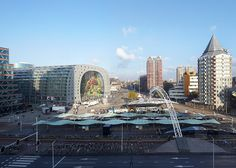 MVRDV's huge horseshoe-shaped market hall and housing development in Rotterdam is captured in these new images by photographers Hufton + Crow