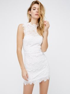 Daydream Bodycon Slip   Bodycon lace slip with a high neck and scalloped trim. Frayed cap sleeves and an open cutout in back. Lining features a sweetheart neckline.