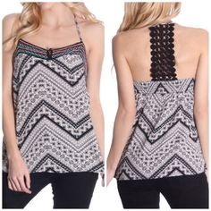 Black & White Tribal Lace Back Tank New without tags and direct from the distributor this tank top featured a pretty tribal print and a sexy lace back. 100% polyester. The back has an elastic hem that stretches to accommodate many chest sizes. Smoke free home. Tops Tank Tops
