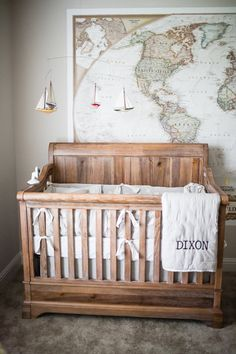 Cozy and adventurous nursery with a large world map on the wall.