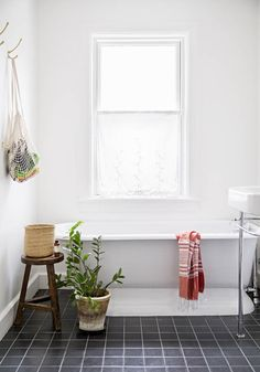 Simple and elegant bathroom via the Style Files. Photo by Brittany Ambridge.