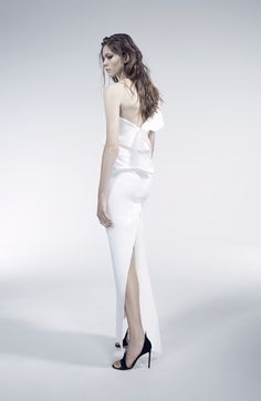 Modern and tailored, this one shoulder **Maticevski** gown folds across the body falling effortsly across one shoulder and down to a slim line skirt to the ankle.