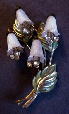 Gold washed copper with exceptional white Pearlescent plastic Lilies of the Valley flowers. This is a book piece twice: once in Harrice Simons Miller's second edition Costume Jewelry Handbook
