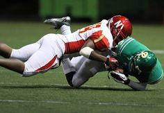 Newport's Tariq Muhammad, left, tackles Roosevelt's Cameron Holand. See more of Seattle Times photographer Colin Diltz's photos from the game.