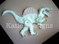 In The Hoop Spinosaurus Jointed Doll Machine Embroidery Design by KatieLDesigns. Fast and easy, put together with mini brads. Would make a great gift or stocking stuffer!