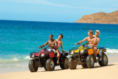 Adults can rent ATVs and ride around on the golden sand beach in Los Cabos!