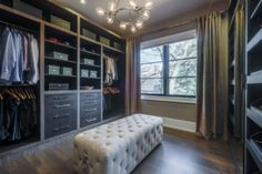 Good set-up for walk-in closet (but with completely different colours/fabrics/finishes.